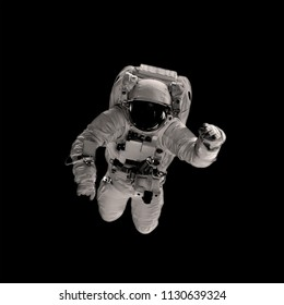 astronaut on the black backgrounds. Elements of this image furnished by NASA