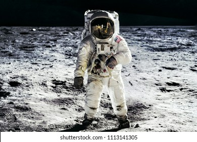 Astronaut on lunar moon landing mission Apollo 11. Astronaut space walk on moon surface in spacesuit. Space,science fiction,galaxy & universe wallpaper. Elements of this image furnished by NASA