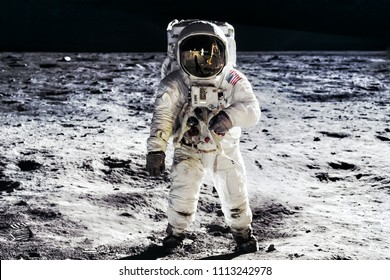 Astronaut on lunar moon landing mission Apollo 11.Astronaut space walk on moon surface in spacesuit.Space,science fiction,galaxy & universe wallpaper. Elements of this image furnished by NASA