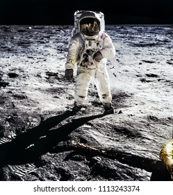 Astronaut on lunar moon landing mission Apollo 11.Astronaut space walk on moon surface in spacesuit. Space,science fiction,galaxy & universe wallpaper. Elements of this image furnished by NASA