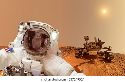 Astronaut on Mars in background a rover - Elements of this image furnished by NASA