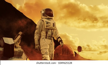 Astronaut on Mars Walking on the Exploring Expedition. In the Background His Base/ Research Station. First Manned Mission To Mars, Technological Advance Brings Space Exploration, Colonization.