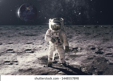 Astronaut on rock surface with space background. Elements of this image furnished by NASA