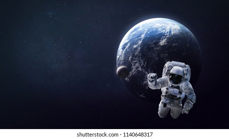 Astronaut in open space near the Earth and Moon. Place for text and infographic. Abstract wallpaper. Elements of this image furnished by NASA