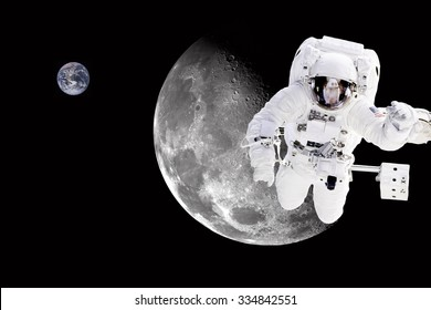 Astronaut in outer space, in background the moon and earth - Elements of this image furnished by NASA