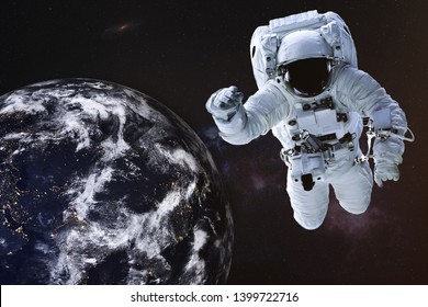 Astronaut in outer space with Earth planet of solar system. Science fiction wallpaper. Elements of this image were furnished by NASA
