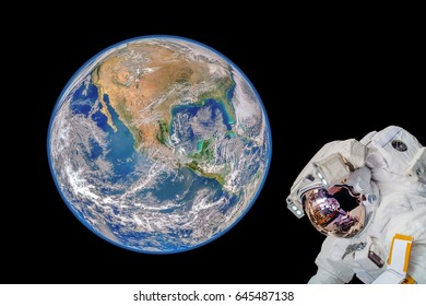 """Astronaut in outer space."""" Elements of this image furnished by NASA"""""""