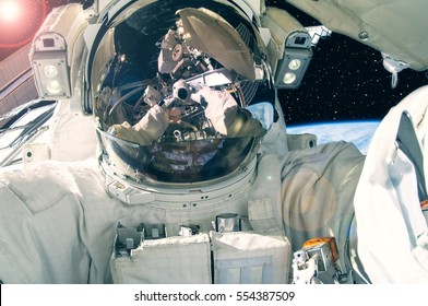 "Astronaut in the outer space. Astronaut makes selfie. ""The elements of this image furnished by NASA"""