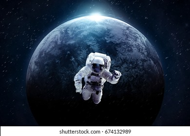 Astronaut in outer space over of the distant deep exoplanet. Science theme. Astronomy concept. Elements of this image furnished by NASA.