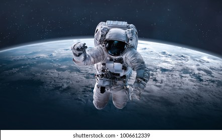 Astronaut in outer space over of the planet Earth. Elements of this image furnished by NASA