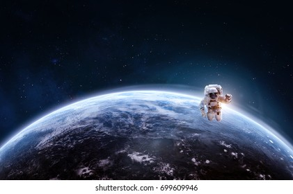 Astronaut in outer space over of the planet earth. Science theme. Astronomy concept. Elements of this image furnished by NASA.