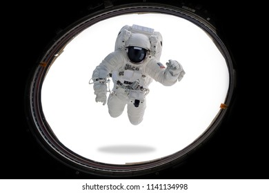 Astronaut in outer space from porthole. Minimal art. Elements of this image furnished by NASA.