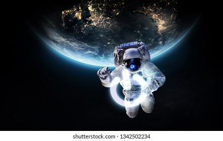 Astronaut in outer space with power button. Earth hour event. Planet on the background. Elements of this image furnished by NASA