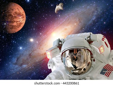 Astronaut planet Mars spaceman helmet man space suit extraterrestrial martian colony. Elements of this image furnished by NASA.