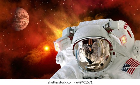Astronaut planet Mars spaceman helmet stars space suit galaxy universe. Elements of this image furnished by NASA.