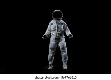 Astronaut posing on black background
