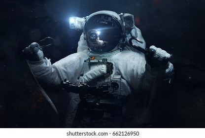 Astronaut. Science fiction space wallpaper, incredibly beautiful planets, galaxies, dark and cold beauty of endless universe. Elements of this image furnished by NASA