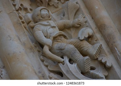 Astronaut at side entrance to Salamanca Cathedral. Salamanca. Castila and Leon. Spain.