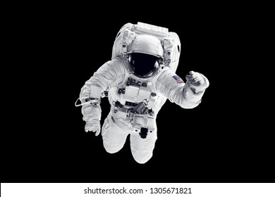 Astronaut in space suit over black background. Elements of this image furnished by NASA