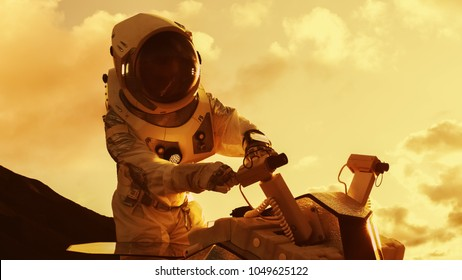 Astronaut in the Space Suit Repairing Rover Cameras on a New Alien Red Planet. Day Light High-Tech Space Exploration, Mission, Discovering and Colonizing Habitable Planets.