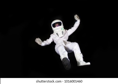 Astronaut in space, in zero gravity on black background.
