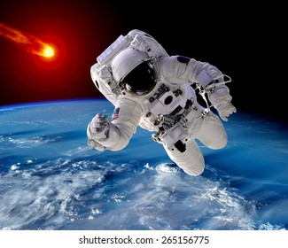 Astronaut spaceman Earth meteor asteroid meteorite space. Elements of this image furnished by NASA.