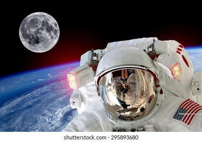 Astronaut spaceman isolated helmet space selfie earth moon. Elements of this image furnished by NASA.