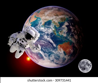 Astronaut spaceman isolated outer space planet earth globe sunrise moon. Elements of this image furnished by NASA.