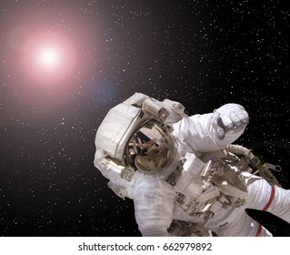 "Astronaut spaceman in outer space. Galaxy on backdrop. ""The elements of this image furnished by NASA"""