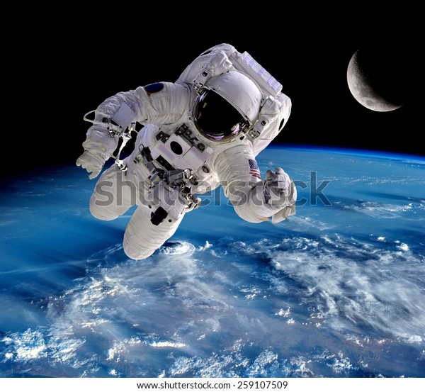 Astronaut spaceman outer space people planet earth moon. Elements of this image furnished by NASA.