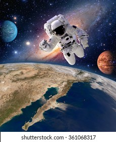Astronaut spaceman solar system planet spacewalk earth outer space walk galaxy. Elements of this image furnished by NASA.