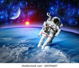 Astronaut spaceman space suit cosmonaut moon earth sun. Elements of this image furnished by NASA.