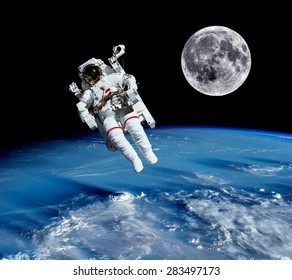 Astronaut spaceman suit earth outer space universe moon. Elements of this image furnished by NASA.