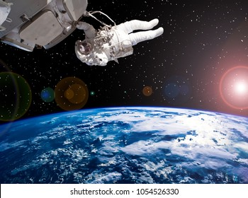 Astronaut and spaceship against deep space. The elements of this image furnished by NASA.