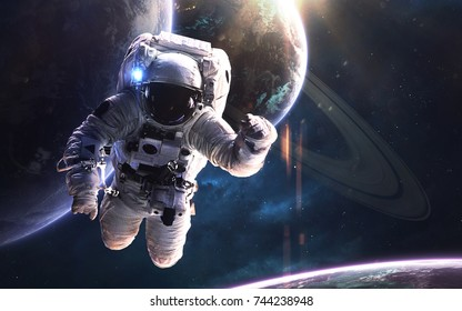 Astronaut at the spacewalk . Deep space image, science fiction fantasy in high resolution ideal for wallpaper and print. Elements of this image furnished by NASA