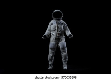 Astronaut in various poses on isolated black background
