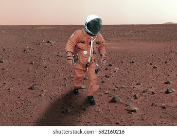 """Astronaut walking on planet mars. """"Elements of this image furnished by NASA"""""""