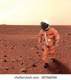 "Astronaut walking on planet mars. ""Elements of this image furnished by NASA"""