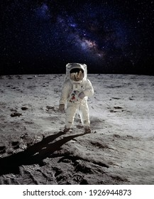 An astronaut walking on the surface of the moon with earth on lunar landing space mission. Elements of this image furnished by NASA.