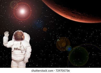 Astronaut waves with a hand and mars on the backside. The elements of this image furnished by NASA.