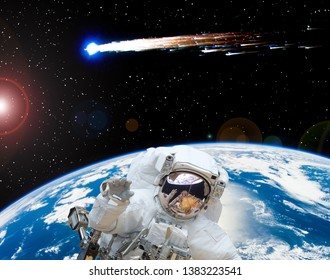 Astronaut waving. Comet. The elements of this image furnished by NASA.