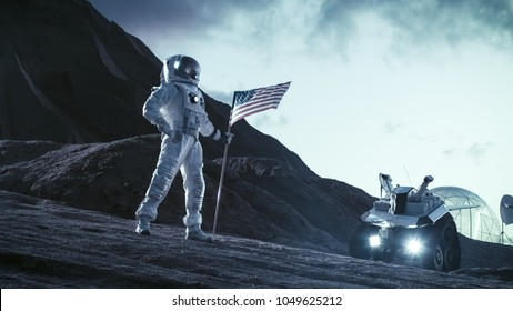 Astronaut Wearing Space Suit Plants American Flag on the Alien Planet. Patriotic and Proud Moment for the Whole of Humanity. Space Travel and Colonization Concept.