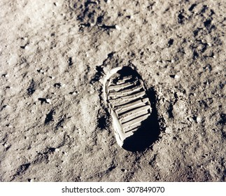 Astronaut's boot print on lunar (moon) landing mission. Elements of this image furnished by NASA.