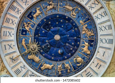 astronomical clock with star sign on old clock tower in venice, italy