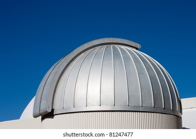 Astronomical Observatory dome by day against a deep blue sky.  Brisbane, Queensland Australia.