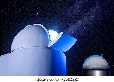 astronomical observatory dome in night with stars and glowing light [Photo Illustration]