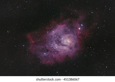 Astrophotography - Colorful purple deep sky nebula in space with clusters of stars