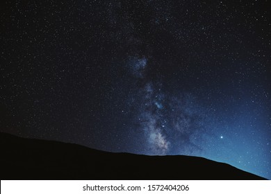 Astrophotography. Milky way with mountains silhouette