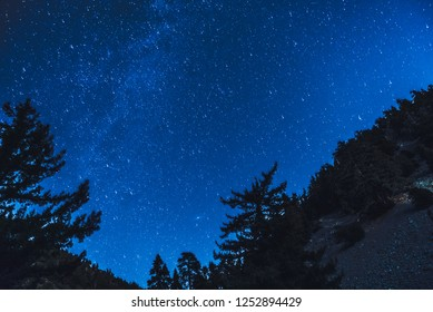 Astrophotography picture of stars through a mountain