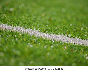 astro-turf american football field close up perspective